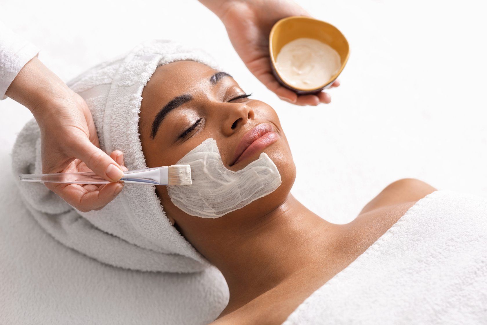Therapist applying face mask